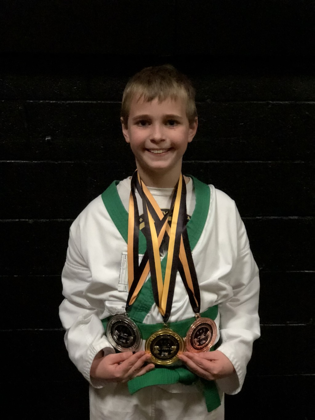 So proud of himself at this Karate Tournament