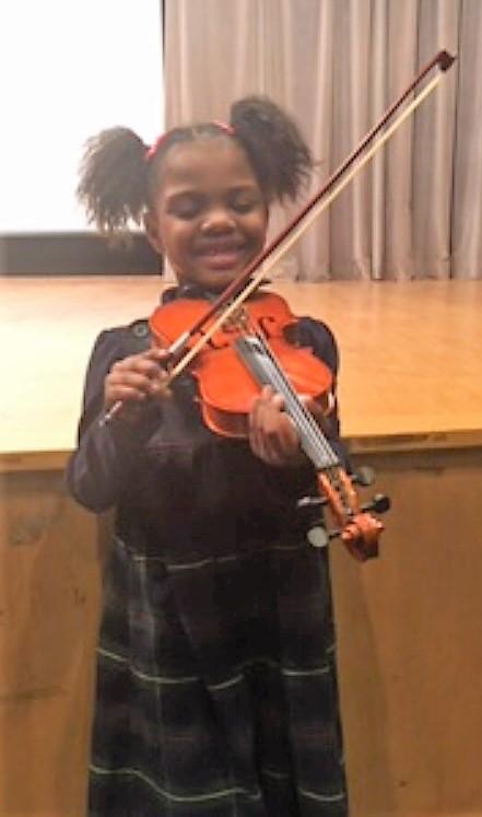 Meeting goals at her violin recital