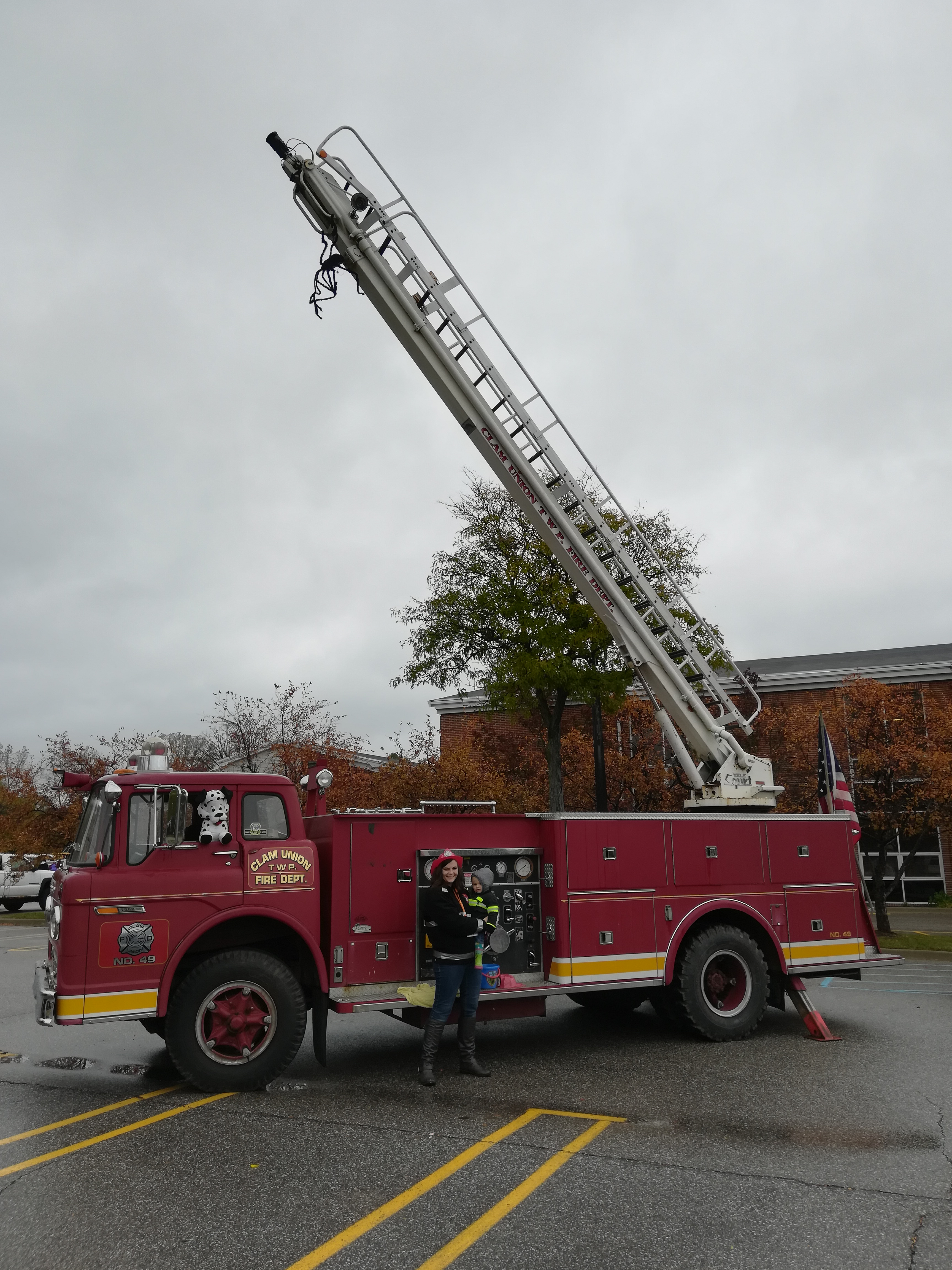 Red Fire Truck with Ladder Raised
